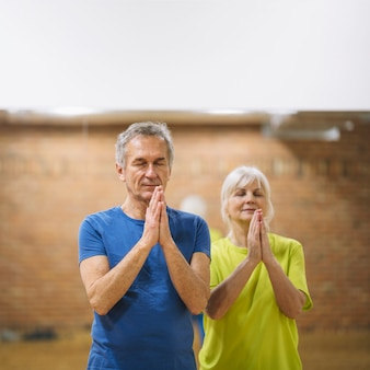 Retired couple meditating