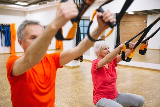 Retired couple training in fitness center