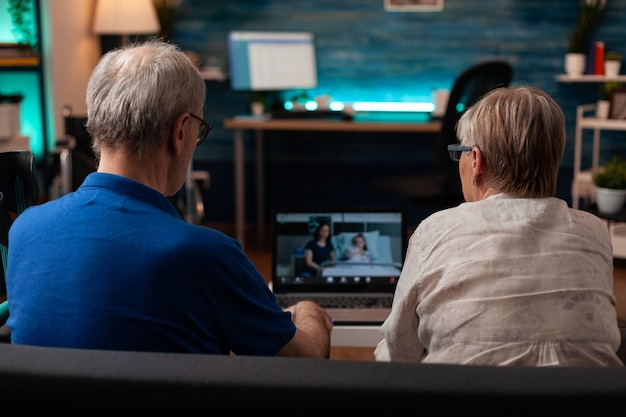 Retired grandparents talking to niece on video call