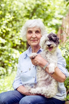Retired woman sitting with her dog