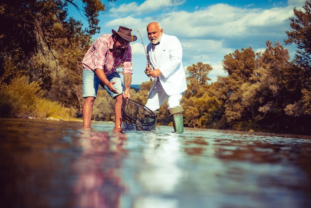 Retirement is just the beginning fisher masculine hobby nice day for fishing hunting against the bac...