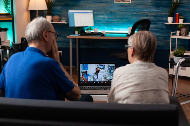 Retirement patients on video call dentist appointment online conference for healing pain prescription medicine. old senior married people using telemedicine to cure healthcare problems