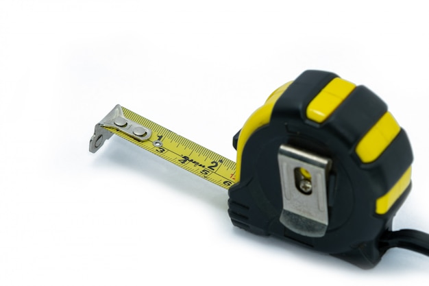 Retractable yellow metal measuring tape isolated