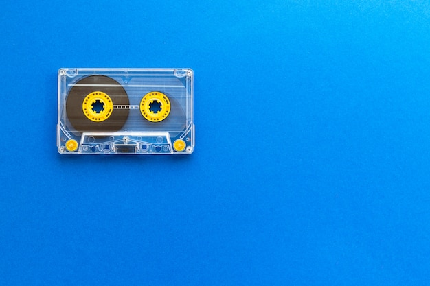 Retro audio tape cassette from 80s and 90s. old technology concept. flat lay, top view with copy space.