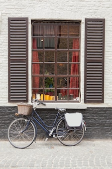Retro bicycle standing near the old window, belgium