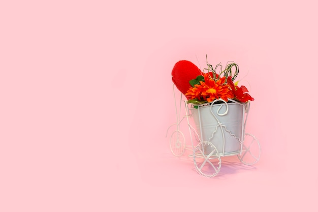 Retro bicycle with pot of bouquet flowers