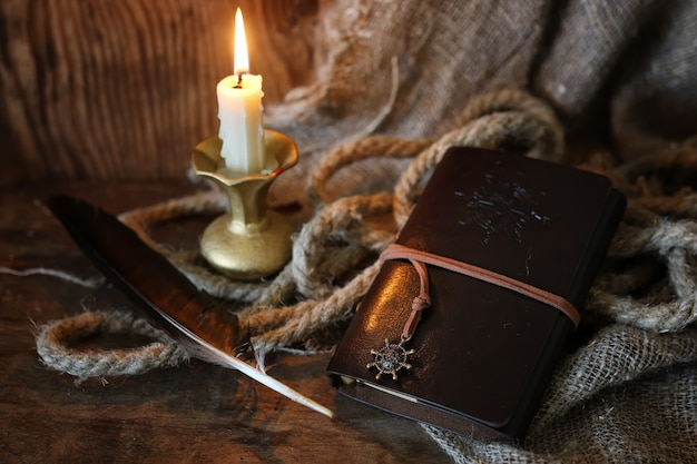 Retro book candle and feather