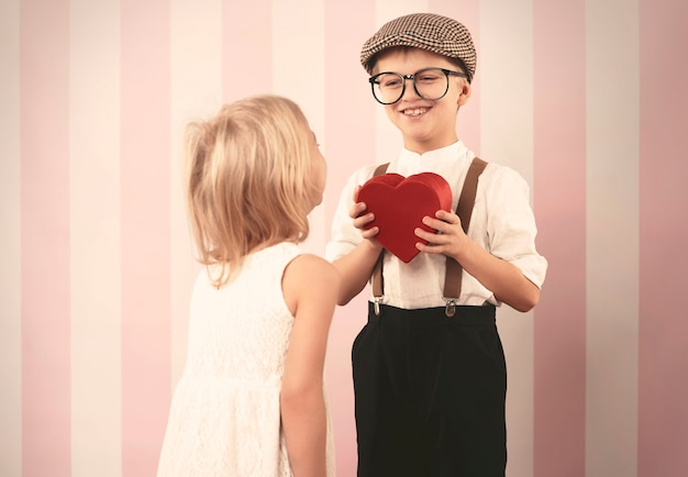 Retro boy giving heart for his love