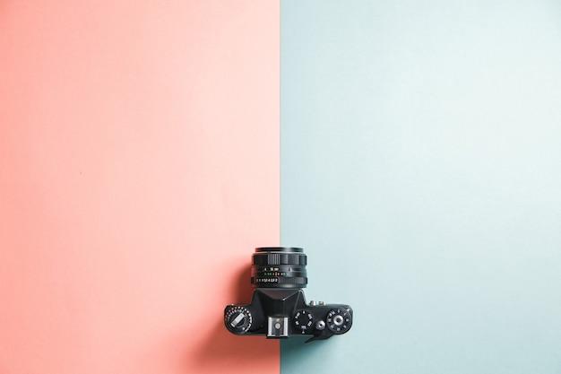 Retro camera on bright background. minimalistic layout of the photographer.