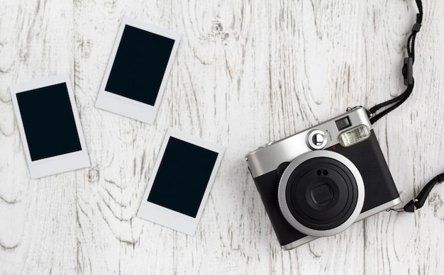 Retro camera and empty old instant paper photo