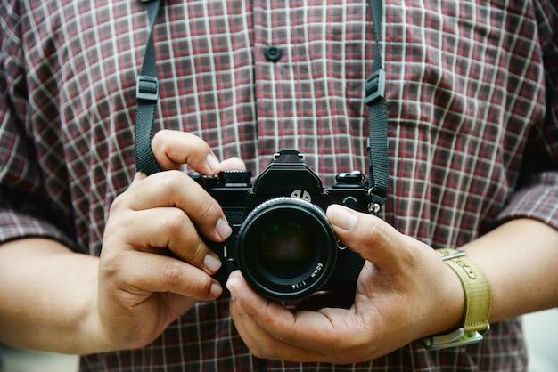Retro camera in photographer hand vintage tone concept