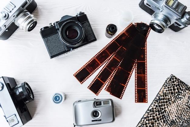 Retro cameras on white background