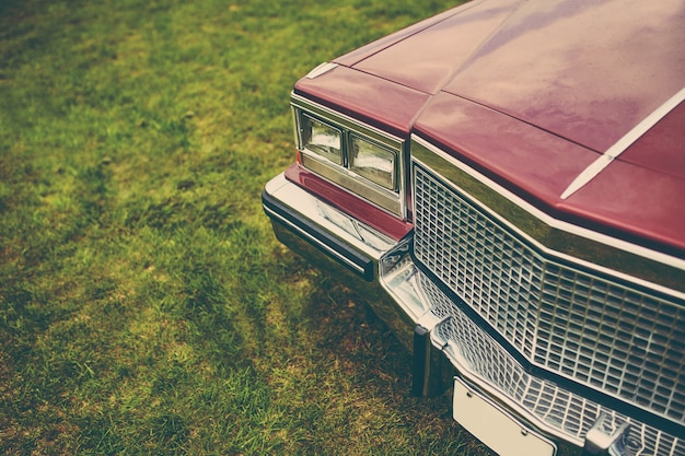 Retro car parked on grass