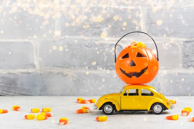 Retro car and pumpkin on it