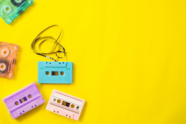 Retro cassette tape recorder on yellow background