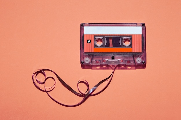 Retro cassette with tape pulled out placed