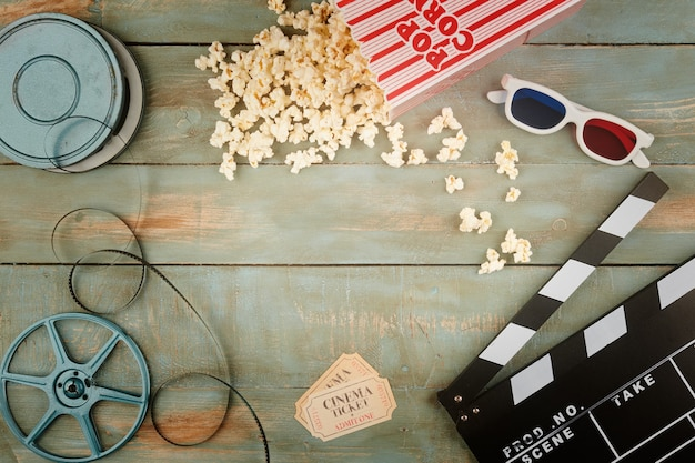 Retro cinema objects on wooden background