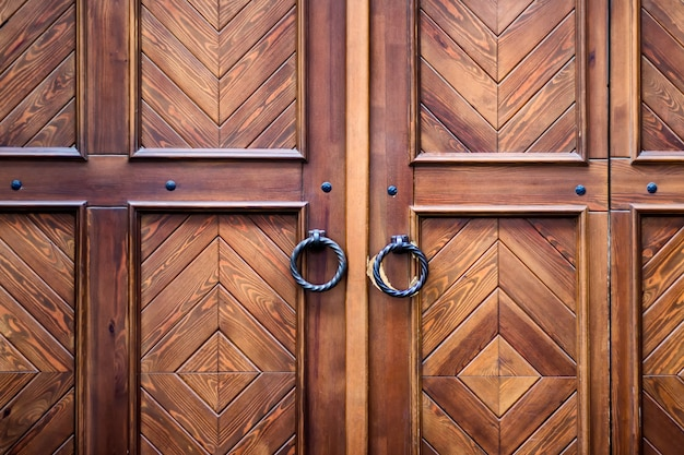 Retro door with beautiful wooden texture and round metal decorative handles