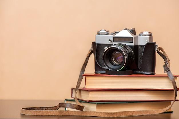 Retro film camera with books on the table
