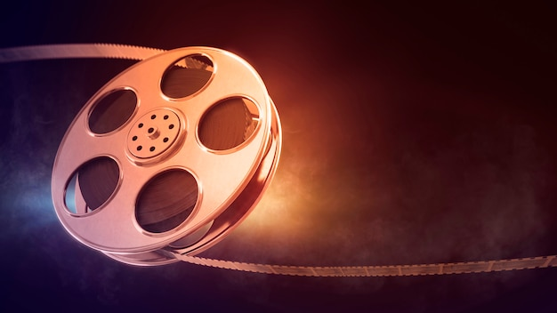 Retro film reel on burn background
