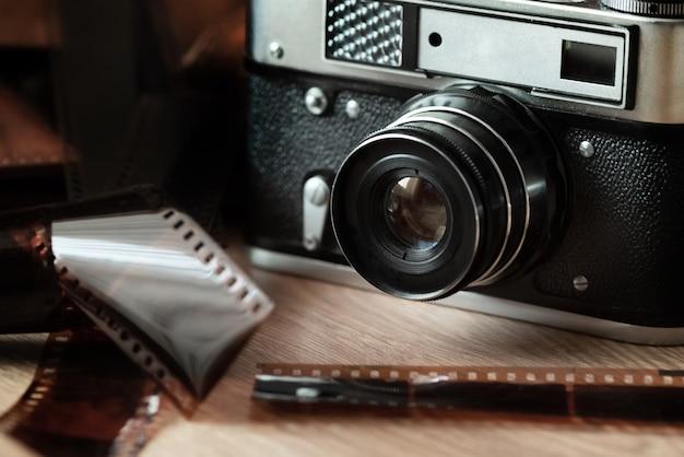 Retro film slr camera photographic film surrounding with filmstrips