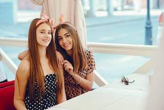 Retro girls in a cafe