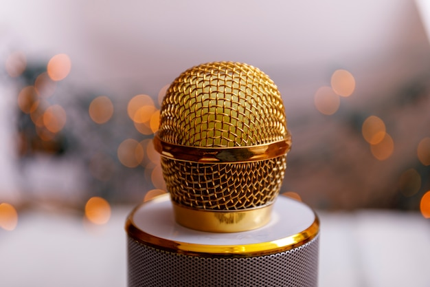 Retro golden classic microphone on table. vintage old style photo with bokeh