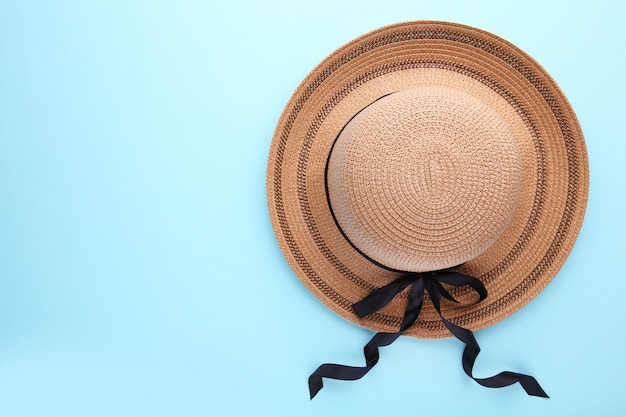 Retro hat with black ribbon on blue. summer concept