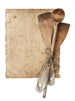 Retro kitchen utensils and old cook book page isolated on white background