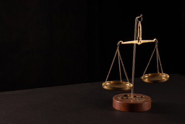 Retro law scales on table. symbol of justice.