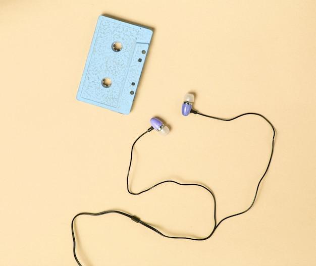 Retro media concept with vacuum earphones and cassette