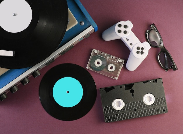 Retro media and entertainment items 80s. vinyl player, video, audio cassettes