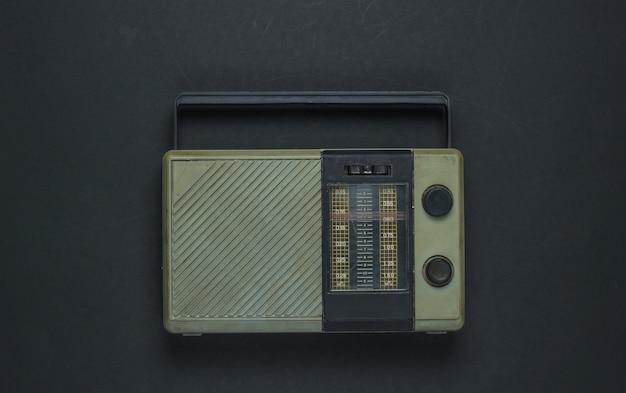 Retro media. radio receiver on black background. top view.