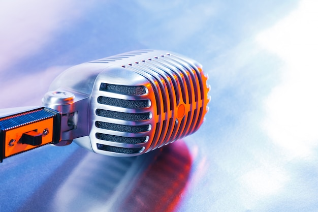 Retro microphone on light blue