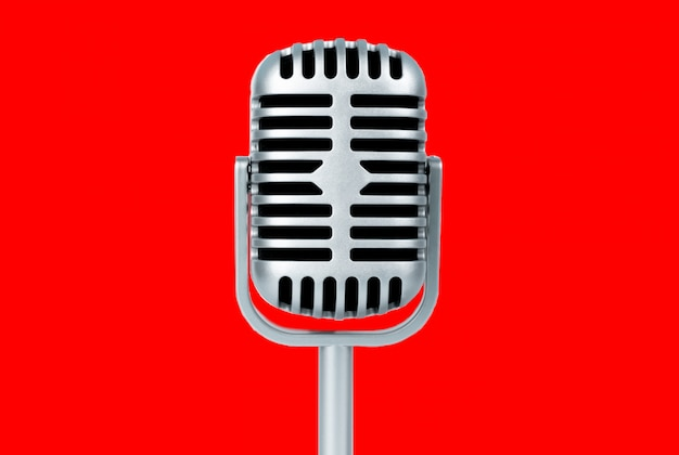 Retro microphone on red background