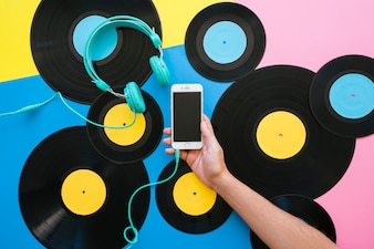 Retro music concept with smartphone and vinyls