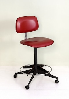Retro office chair with red seat and wheels