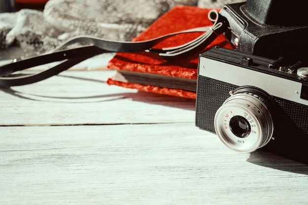 Retro old camera with black leather case and vintage photo album