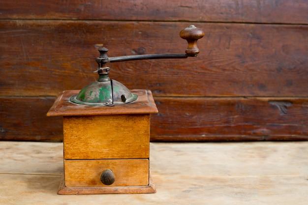 Retro old coffee grinder in vintage wood