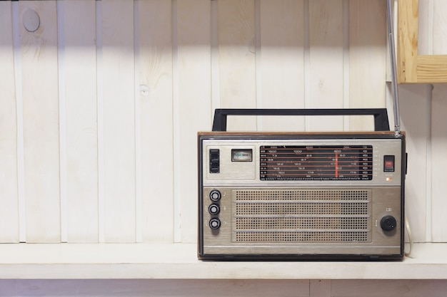 Retro old radio front white wooden background. vintage style photo.