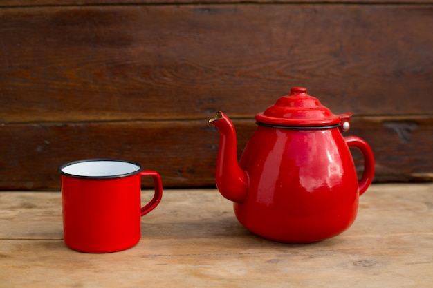 Retro old vintage teapot and red cup