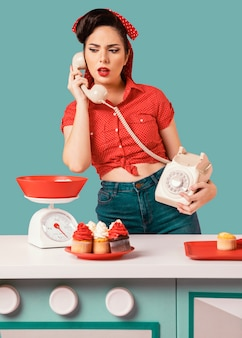 Retro pinup girl posing in a kitchen