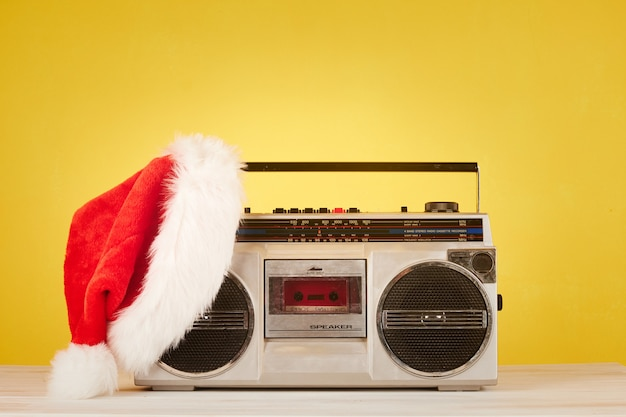 Retro radio cassette with christmas hat
