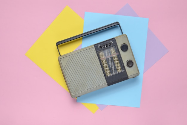Retro radio receiver on a colored paper background. minimalism. top view