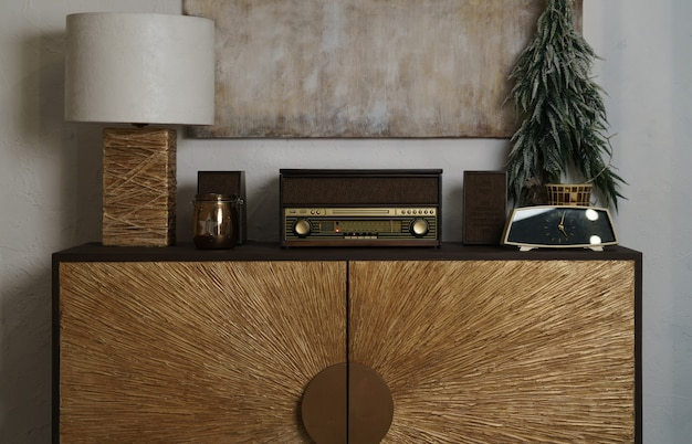 Retro radio and table lamp on decorated wooden counter