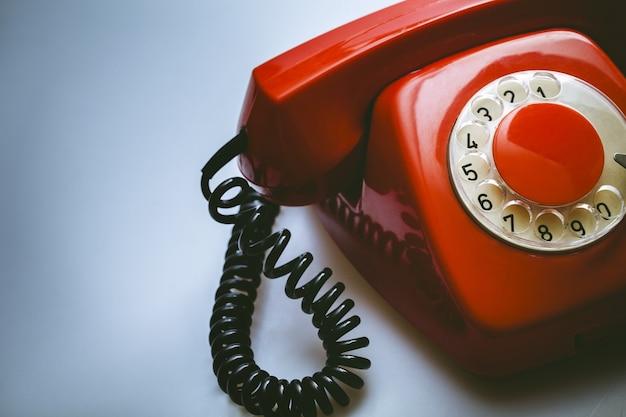 Retro red telephone on  background