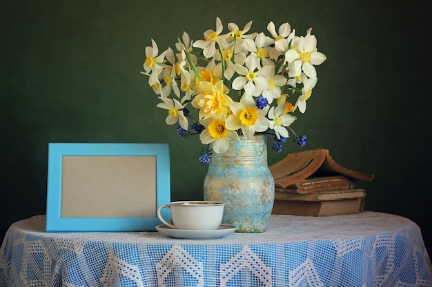 Retro still life with a bouquet of daffodils on a green background.