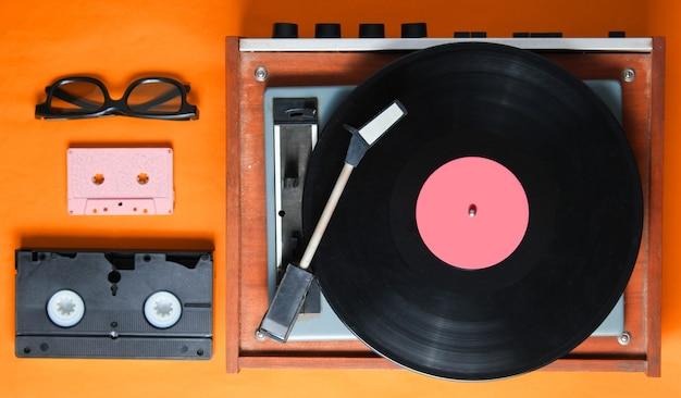 Retro style, 80s, pop culture attributes on orange background