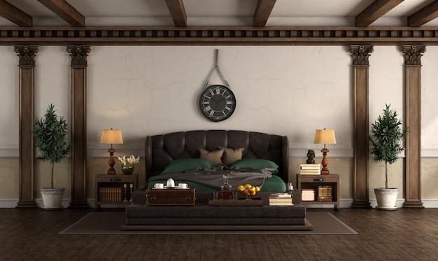 革のダブルベッドがレトロなスタイルのベッドルーム