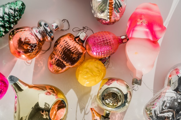 Retro style christmas tree baubles on white background with shadows.